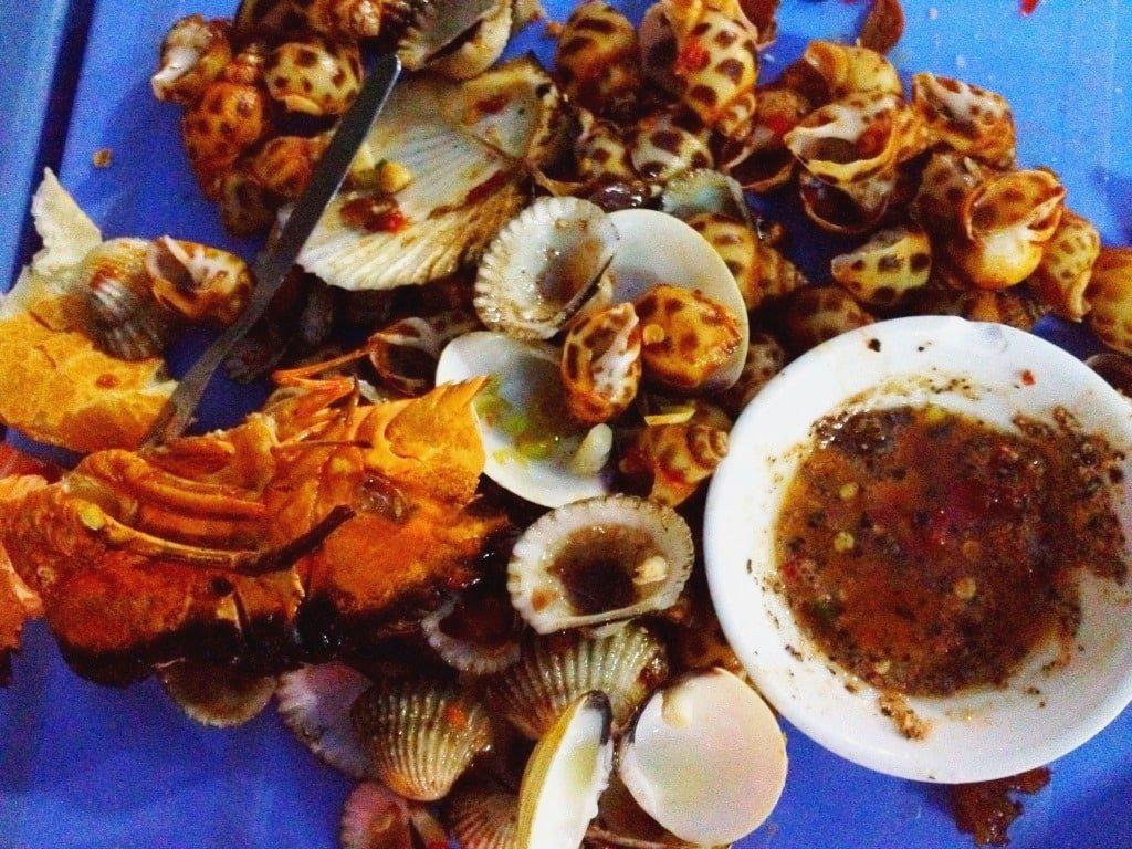 Snail eating mess, Saigon, Vietnam