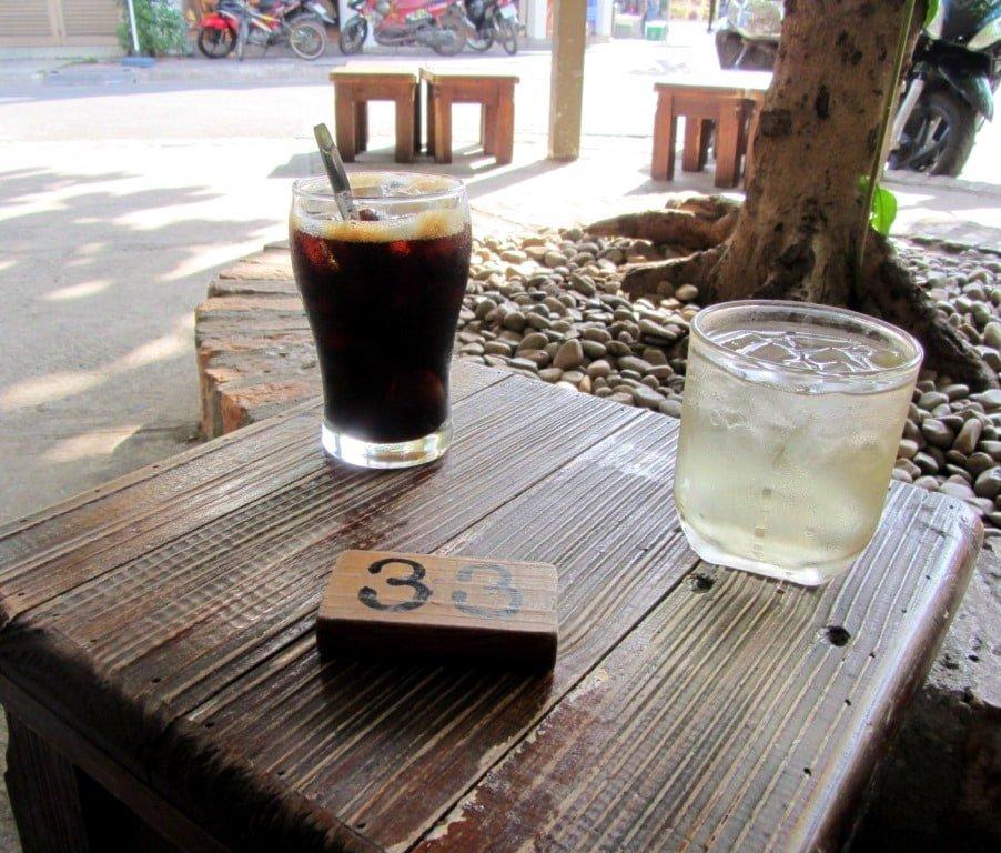Wooden stools at Ghế Đẩu Cafe