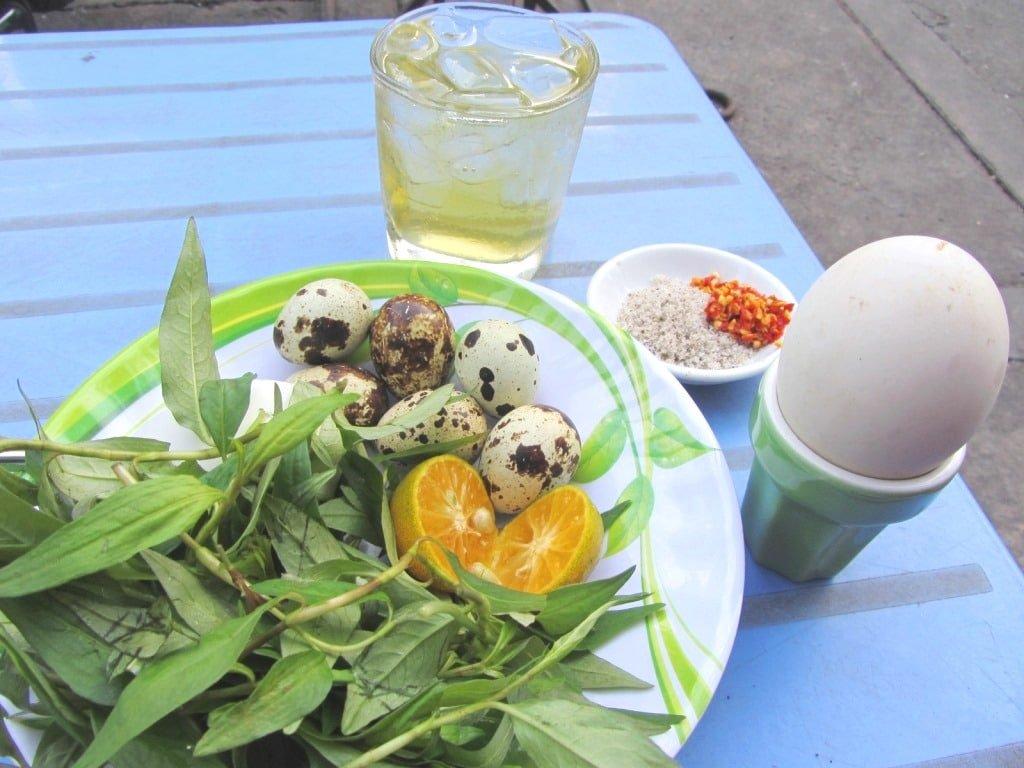 Fetal duck and quail eggs, Saigon, Vietnam