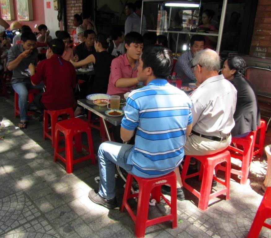 Lunchtime rush at a common rice eatery, Vietnam