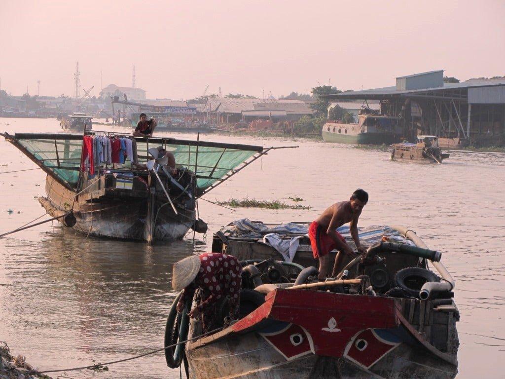 Dawn preparations on a wooden junk, Mekong Delta