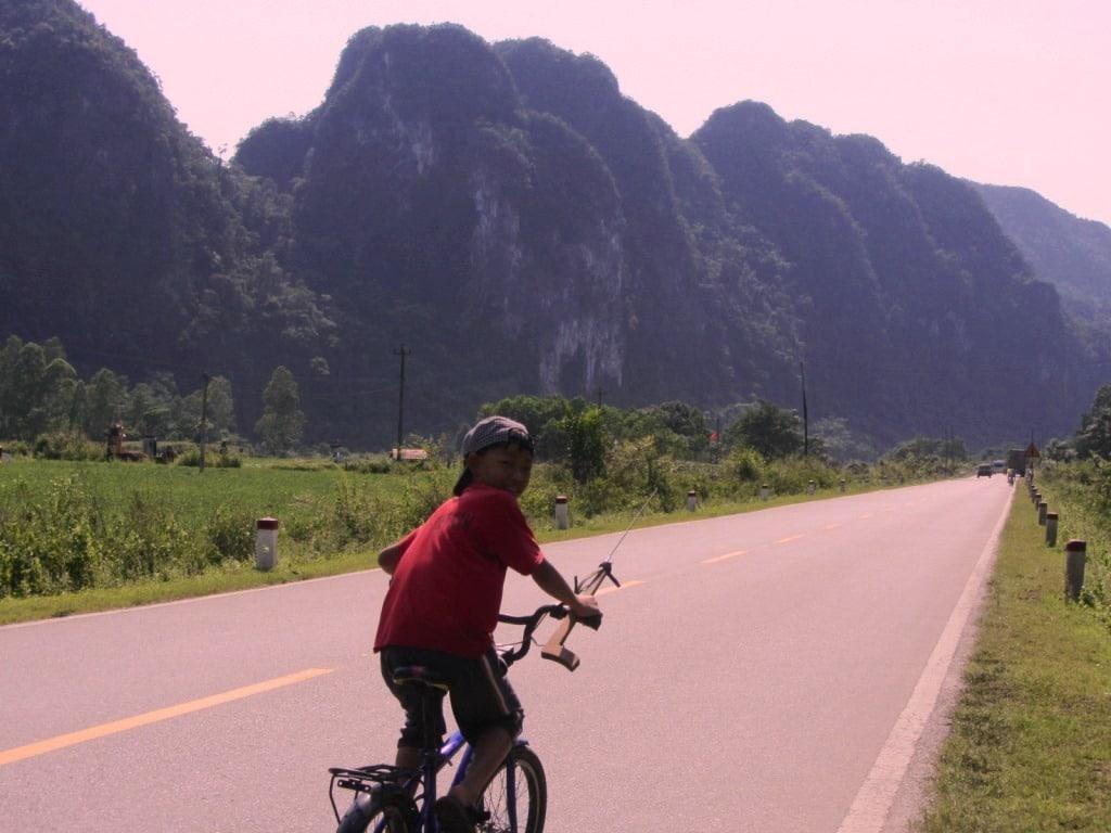Boy on a bicycle, Ho Chi Minh Road, Vietnam