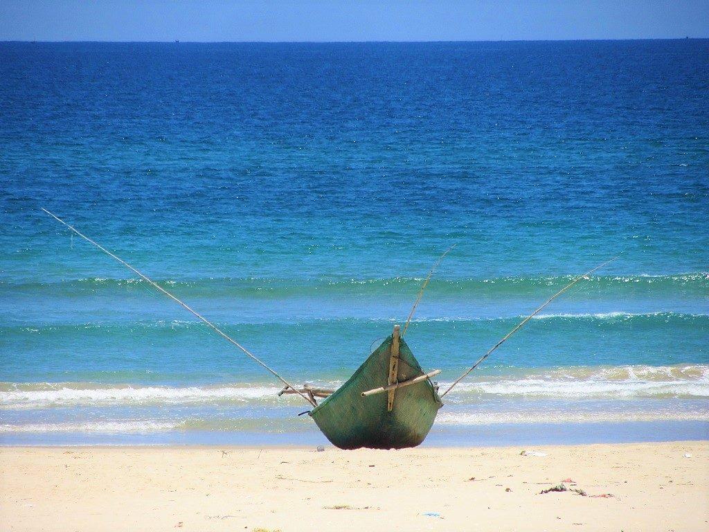 Fishing canoe, Quang Nam coast, near Hoi An, Vietnam