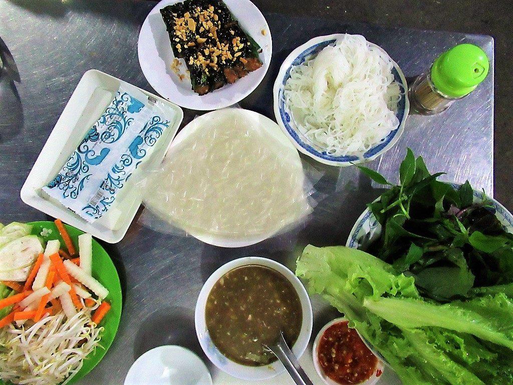 Bò lá lốt (grilled beef in betel leaf) by the Saigon rail tracks