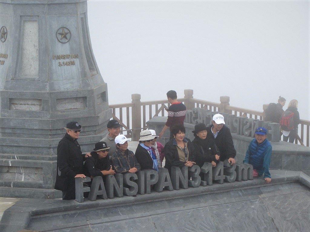 Tour groups at Fansipan mountain summit, Vietnam