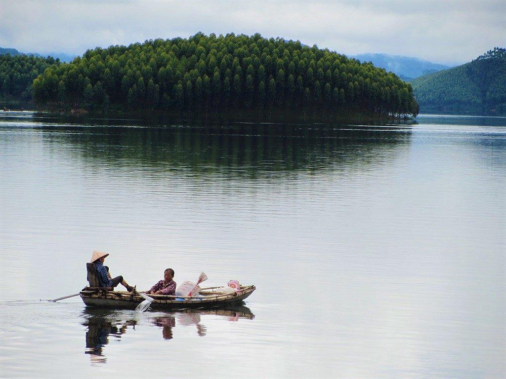 Rowing a boat on Thac Ba Lake, Vu Linh, Ye Bai Province, Vietnam