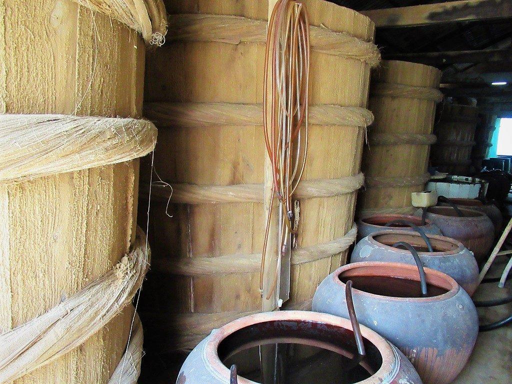 Wooden barrels of nước mắm (fish sauce), Hon Son Island, Vietnam
