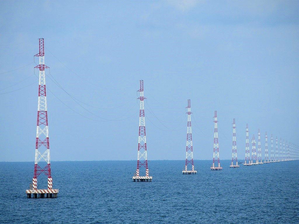 Electricity pylons in the sea, Hon Son Island, Vietnam