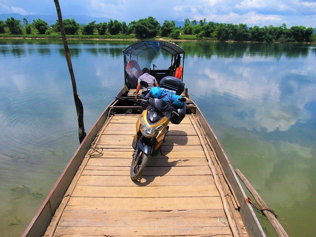 Wooden vehicle ferry across the river, Phong Nha, Vietnam