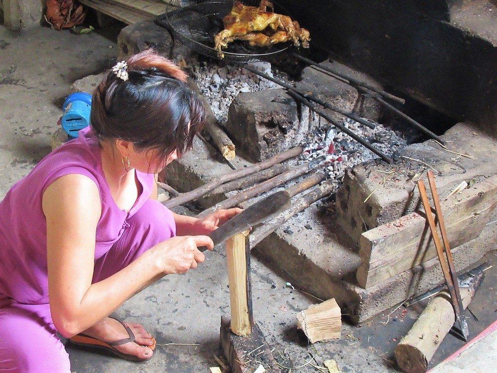 Cooking a chicken feast at Moi Moi, Bong Lai Valley, Phong Nha