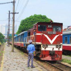 Hanoi to Hai Phong by Train: Passengers & Motorbikes