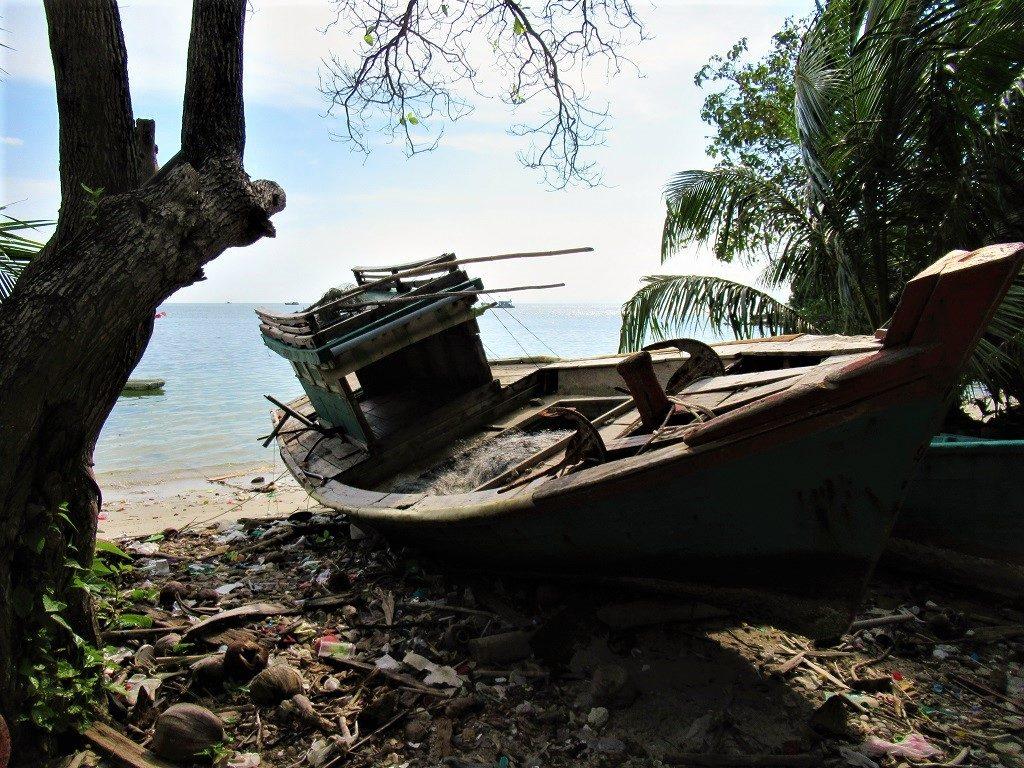 A beach, abandoned boat, Pirate Island, Hai Tac Archipelago, Vietnam