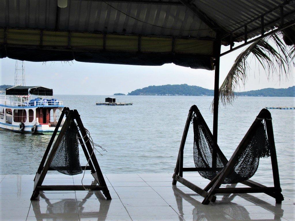 Hammocks by the sea, looking to Hon Tre Vinh Island, Hai Tac Archipelago, Vietnam