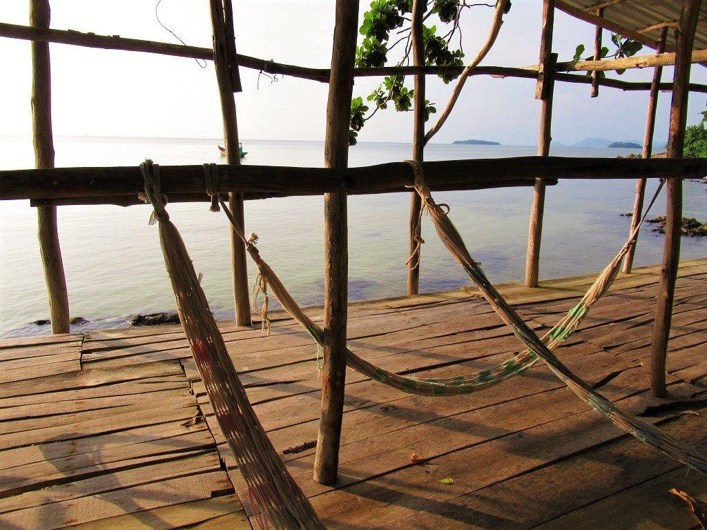 Beach hammocks on Pirate Island, Hai Tac Archipelago, Vietnam