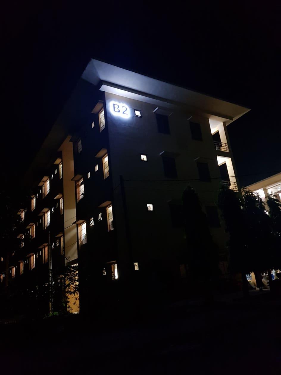 Night, exterior, COVID-19 quarantine facility, Vietnam